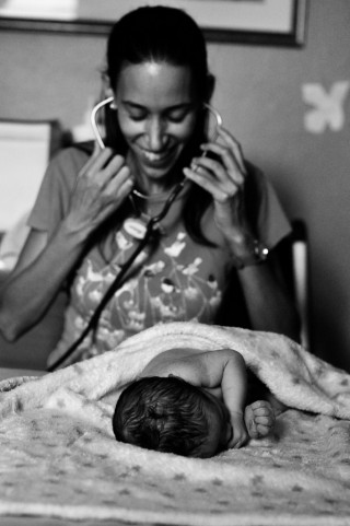 Gina Dacosta checks a newly born infant.